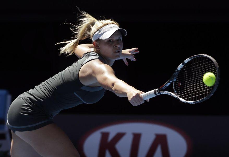 Jana Fett of Croatia makes a backhand return to Elizaveta Kulichkova of Russia in their girls' singles final at the Australian Open tennis championship in Melbourne, Australia, Saturday, Jan. 25, 2014. (AP Photo/Aijaz Rahi)