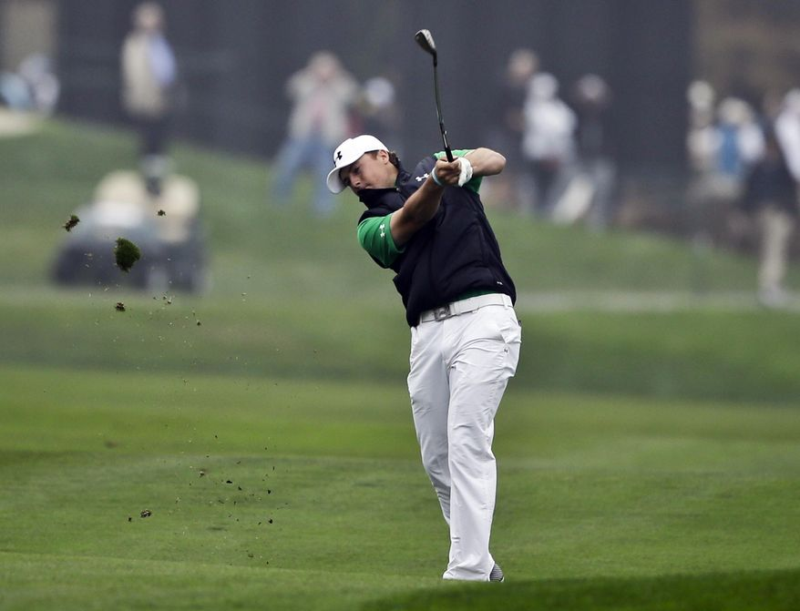 Jordan Spieth hits his approach shot on the 10th hole of the North Course at Torrey Pines during the second round of the Farmers Insurance Open golf tournament Friday, Jan. 24, 2014, in San Diego. (AP Photo/Lenny Ignelzi)