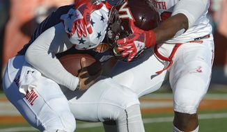 North quarterback Logan Thomas of Virginia Tech (3) is sacked by South defensive end Dee Ford of Auburn (30) during the first quarter of the Senior Bowl NCAA college football game on Saturday, Jan. 25, 2014, in Mobile, Ala. (AP Photo/G.M. Andrews)