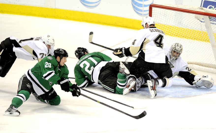 Dallas Stars center Cody Eakin (20) tries to get a shot off on Pittsburgh Penguins goalie Marc-Andre Fleury (29) in the second period during an NHL hockey game, Saturday, Jan. 25, 2014, in Dallas. (AP Photo/Matt Strasen)
