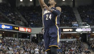 Indiana Pacers guard Paul George goes up for the breakaway layup against the Sacramento Kings during the first quarter of an NBA basketball game in Sacramento, Calif., Friday, Jan. 24, 2014. (AP Photo/Rich Pedroncelli)