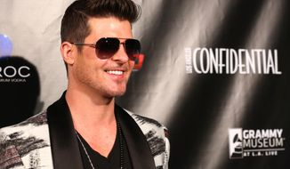 Robin Thicke  arrives Friday Jan. 24, 2014  to the Los Angeles Confidential magazine, CBS Radio and the GRAMMY Museum at L.A. LIVE to celebrate The Grammys in Los Angeles. (Photo by Alexandra Wyman/Invision/AP)