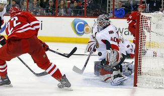 Carolina Hurricanes' Manny Malhotra (22) shoots the puck past Ottawa Senators goalie Robin Lehner (40) for a goal during the second period of an NHL hockey game in Raleigh, N.C., Saturday, Jan. 25, 2014. (AP Photo/Karl B DeBlaker)
