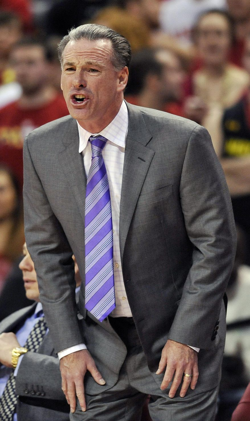 Pittsburgh coach Jamie Dixon calls to his team in the second half of an NCAA college basketball game against Maryland, Saturday, Jan. 25, 2014, in College Park, Md. Pittsburgh won 83-79. (AP Photo/Gail Burton)