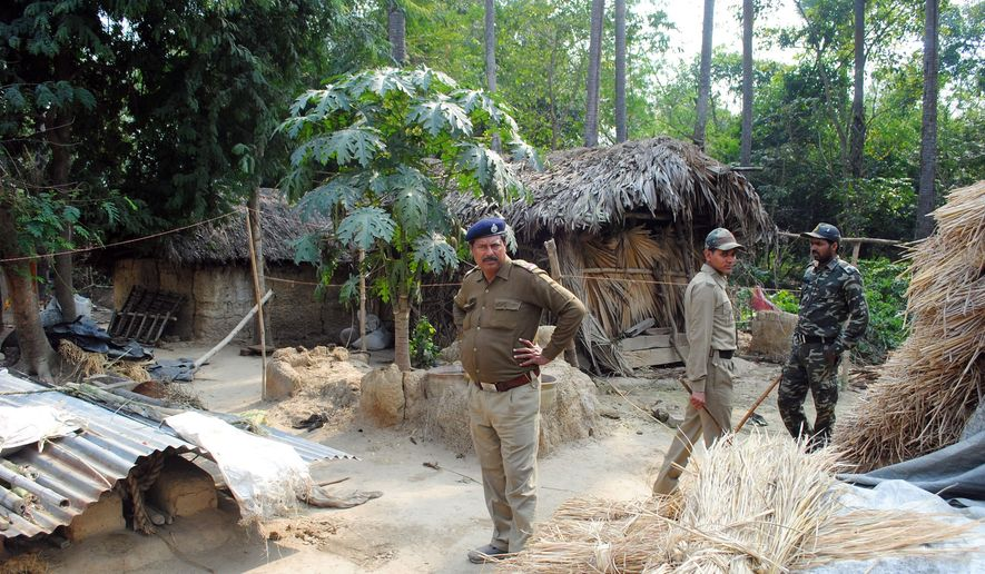 Policemen inspect the site where a woman was gang-raped, allegedly on the direction of a village council at Subalpur village, in Birbhum district, about 180 kilometers (110 miles) north of Kolkata, the capital of the eastern Indian state of West Bengal, Friday, Jan. 24, 2014. (AP Photo, file) ** FILE **
