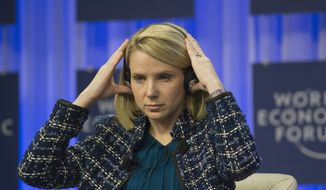 Yahoo CEO Marissa Mayer, puts a headset during a session at the World Economic Forum in Davos, Switzerland, Saturday, Jan. 25, 2014. (AP Photo/Michel Euler)