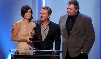 "From left, Kacey Musgraves, Shane McAnally and Josh Osborne accept the best country song award for ""Merry Go 'Round"" at the pre-telecast of the 56th annual GRAMMY Awards on Sunday, Jan. 26, 2014, in Los Angeles. (Photo by Matt Sayles/Invision/AP)"