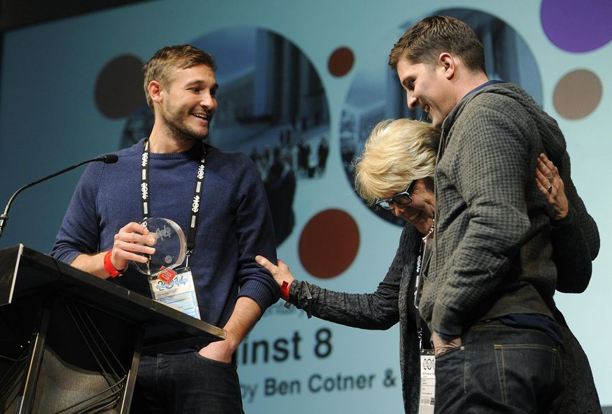 """Ryan White, left, and Ben Cotner, co-directors of """"The Case Against 8,"""" are joined by their editor Kate Amend onstage after they won the Directing Award: Documentary for their film during the 2014 Sundance Film Festival Awards Ceremony on Saturday, Jan. 25, 2014, in Park City, Utah. (Photo by Chris Pizzello/Invision/AP)"""
