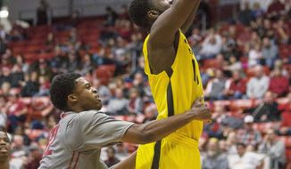 Oregon forward Richard Amardi (13) shoots while drawing a foul on Washington State guard Que Johnson, left, during the first half of an NCAA college basketball game, Sunday, Jan. 26, 2014, in Pullman, Wash. (AP Photo/Dean Hare)