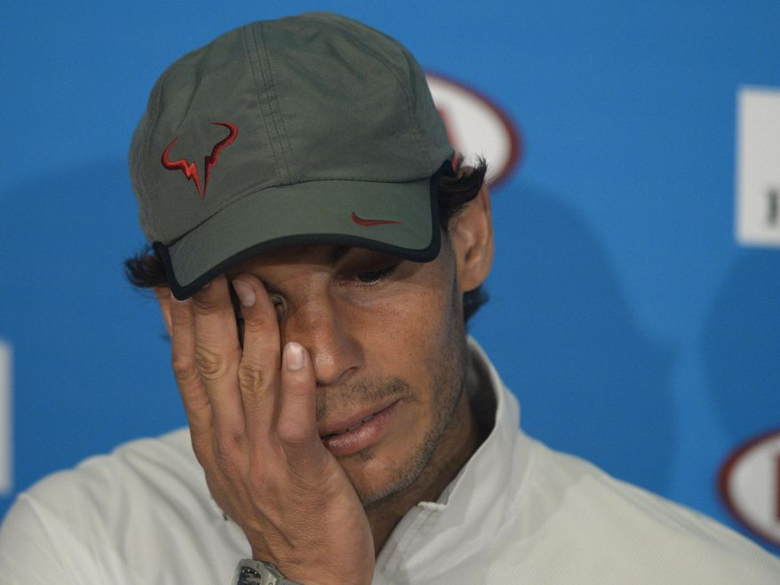 Rafael Nadal of Spain speaks during a press conference after his loss to Stanislas Wawrinka of Switzerland in the men's singles final at the Australian Open tennis championship in Melbourne, Australia, Sunday, Jan. 26, 2014. (AP Photo/Andrew Brownbill)