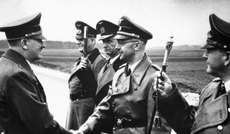 The May 18, 1944, file photo shows then German Chancellor Adolf Hitler, left, shaking hands with German Interior Minister and head of the SS, Heinrich Himmler, somewhere in Germany. From left to right; Hitler, Minister Field Marshal Wilhelm Keitel, Admiral Karl Doenitz, Himmler and Field Marshal General Erhard Milch. (AP Photo/str, File) ** FILE **