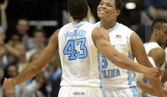 North Carolina's James Michael McAdoo (43) reacts with Kennedy Meeks (3) during an NCAA college basketball game against Clemson on Sunday, Jan. 26, 2014, in Chapel Hill, N.C. (AP Photo/The Herald-Sun, Bernard Thomas)
