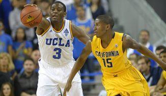UCLA guard Jordan Adams, left, grabs a loose ball away from Cal guard Jordan Mathews during the second half of an NCAA college basketball game, Sunday, Jan. 26, 2014, in  Los Angeles. (AP Photo/Mark J. Terrill)