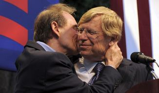 """FILE - In an Aug. 4, 2010 file photo, attorney David Boies kisses fellow lawyer Theodore Olson on the cheek at a public rally in West Hollywood, Calif. Olson and Boies fought on opposite sides of the case that determined the 2000 presidential election, but the veteran attorneys joined forces to defeat California's gay-marriage ban, a five-year effort documented in """"The Case Against 8,"""" which premiered at the Sundance Film Festival. The film follows the attorneys and plaintiffs in the lawsuit that resulted in the marriage ban being overturned. """"The Case Against 8"""" is set to air on HBO in June. (AP Photo/Adam Lau, File)"""