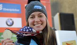 Placed first United States' Kate Hansen displays her medal during the award ceremony of the women's race at the Luge World Cup event  in Sigulda, Latvia, Saturday, Jan. 25, 2014. (AP Photo/Roman Koksarov, F64)