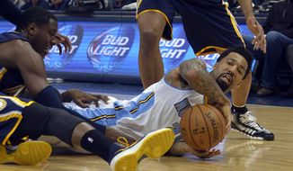 Denver Nuggets small forward Wilson Chandler grabs a loose ball against the Indiana Pacers during the third quarter of an NBA basketball game Saturday, Jan. 25, 2014, in Denver. (AP Photo/Jack Dempsey)
