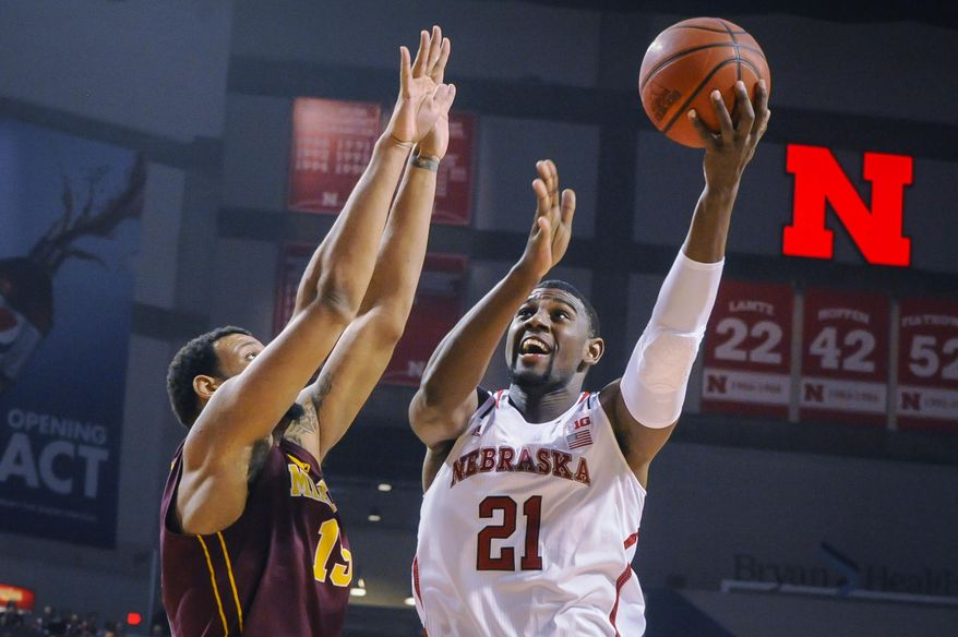 Nebraska Cornhuskers forward Leslee Smith (21) takes a shot in front of Minnesota Golden Gophers forward Maurice Walker (15) during their Sunday, Jan. 26, 2014 NCAA basketball game at the Pinnacle Bank Arena in Lincoln, Neb. (AP Photo/Dave Weaver)