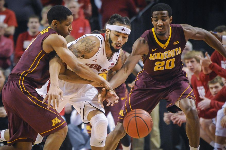 Nebraska Cornhuskers guard/forward Terran Petteway (5) goes for a loose ball against Minnesota Golden Gophers guard Austin Hollins (20) during their Sunday, Jan 26, 2014 NCAA mens basketball game at the Pinnacle Bank Arena in Lincoln, Neb. (AP Photo/Dave Weaver)