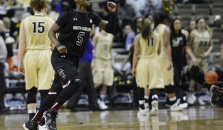 South Carolina guard Khadijah Sessions (5) celebrates as Vanderbilt players walk off the court after South Carolina defeated Vanderbilt 61-57 in an NCAA college basketball game Sunday, Jan. 26, 2014, in Nashville, Tenn. (AP Photo/Mark Zaleski)