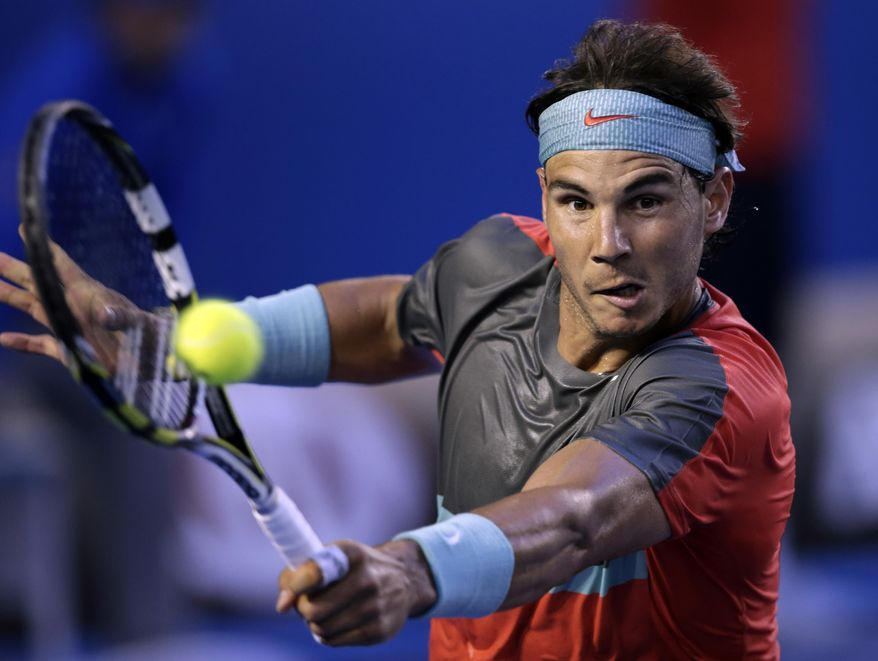 Rafael Nadal of Spain makes a backhand return to Stanislas Wawrinka of Switzerland during the men's singles final at the Australian Open tennis championship in Melbourne, Australia, Sunday, Jan. 26, 2014.(AP Photo/Rick Rycroft)