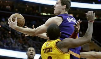 Phoenix Suns' Goran Dragic, from Slovenia, goes in for a shot against Cleveland Cavaliers' Kyrie Irving (2) in the first quarter of an NBA basketball game, Sunday, Jan. 26, 2014, in Cleveland. (AP Photo/Mark Duncan)