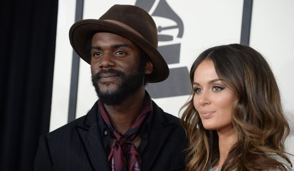 Gary Clark Jr., left, and Nicole Trunfio arrive at the 56th annual GRAMMY Awards at Staples Center on Sunday, Jan. 26, 2014, in Los Angeles. (Photo by Jordan Strauss/Invision/AP)