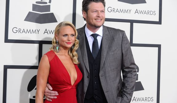 Miranda Lambert, left, and Blake Shelton arrive at the 56th annual GRAMMY Awards at Staples Center on Sunday, Jan. 26, 2014, in Los Angeles. (Photo by Jordan Strauss/Invision/AP)