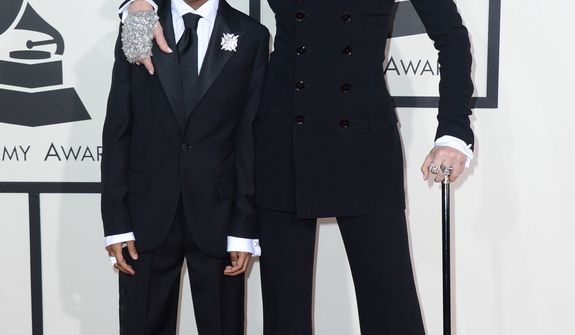 Madonna, right, arrives with her son David Ritchie at the 56th annual GRAMMY Awards at Staples Center on Sunday, Jan. 26, 2014, in Los Angeles. (Photo by Jordan Strauss/Invision/AP)