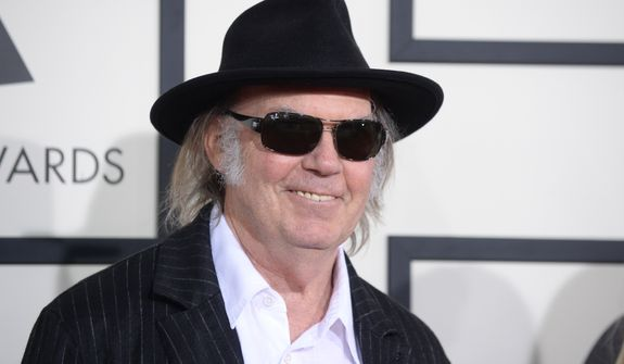 Neil Young arrives at the 56th annual GRAMMY Awards at Staples Center on Sunday, Jan. 26, 2014, in Los Angeles. (Photo by Jordan Strauss/Invision/AP)