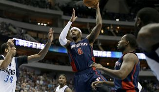 Detroit Pistons forward Josh Smith (6) finds an opening to the basket against Dallas Mavericks' Brandan Wright (34) in the first half of an NBA basketball game, Sunday, Jan. 26, 2014, in Dallas. (AP Photo/Tony Gutierrez)