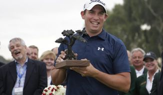Scott Stallings holds the trophy after winning the Farmers Insurance Open golf tournament Sunday, Jan. 26, 2014, in San Diego. (AP Photo/Gregory Bull)