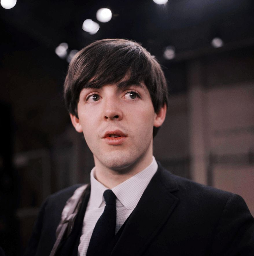 "FILE - This Feb. 1964 file photo shows the Beatles' Paul McCartney on the set of the ""Ed Sullivan Show,"" in New York. McCartney and Ringo Starr will attend the Recording Academy's Special Merit Awards ceremony, on Saturday, Jan. 25, 2014, where the Beatles will be honored with a lifetime achievement award, in Los Angeles.  (AP Photo/File)"
