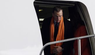 Denver Broncos' Peyton Manning arrives at Newark Liberty International Airport for the NFL Super Bowl XLVIII football game, Sunday, Jan. 26, 2014, in Newark, N.J. (AP Photo/Julio Cortez)