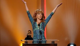 """Kathy Griffin accepts the best comedy album award for """"Calm Down Gurrl"""" at the pre-telecast of the 56th annual GRAMMY Awards on Sunday, Jan. 26, 2014, in Los Angeles. (Photo by Matt Sayles/Invision/AP)"""