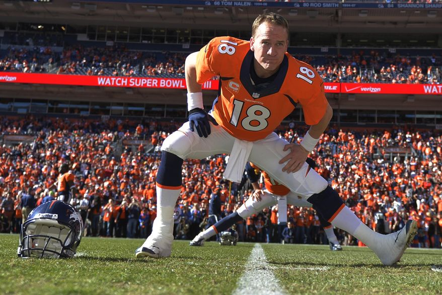 ADVANCE FOR WEEKEND EDITIONS, JAN. 25-26 - In this Jan. 19, 2014, file photo, Denver Broncos quarterback Peyton Manning loosens up before the AFC Championship NFL playoff football game against New England Patriots in Denver. When he faces the Seattle Seahawks next Sunday, Manning can become the first starting quarterback to win the Super Bowl with two franchises. (AP Photo/Jack Dempsey, File)