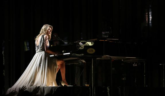 """Taylor Swift performs """"All Too Well"""" on stage at the 56th annual Grammy Awards at Staples Center on Sunday, Jan. 26, 2014, in Los Angeles. (Photo by Matt Sayles/Invision/AP)"""