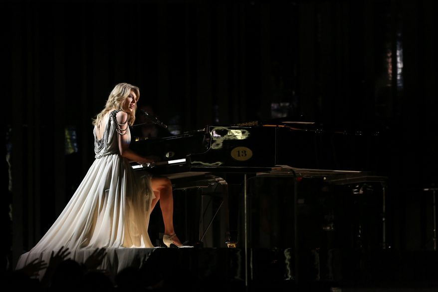 "Taylor Swift performs ""All Too Well"" on stage at the 56th annual Grammy Awards at Staples Center on Sunday, Jan. 26, 2014, in Los Angeles. (Photo by Matt Sayles/Invision/AP)"