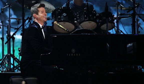 Robin Thicke performs a medley of songs at the 56th annual Grammy Awards at Staples Center on Sunday, Jan. 26, 2014, in Los Angeles. (Photo by Matt Sayles/Invision/AP)