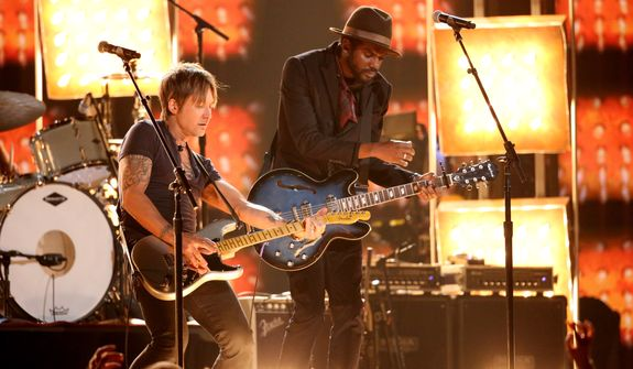 """Keith Urban, left, and Gary Clark, Jr. perform """"Cop Car"""" on stage at the 56th annual Grammy Awards at Staples Center on Sunday, Jan. 26, 2014, in Los Angeles. (Photo by Matt Sayles/Invision/AP)"""