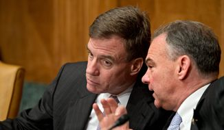 ** FILE ** Sen. Mark R. Warner (left) and Sen. Tim Kaine accepted thousands of dollars worth of tickets to professional football, basketball, hockey and auto racing events while they served as governors of Virginia. (Associated Press)