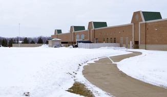 In a Jan. 18, 2014 photo, the east side of the Tecumseh High School in Tecumseh, Mich., is seen. Art teacher Christine Obeid and her students are planning an outdoor sculpture garden to be located on the area pictured. (AP Photo/The Daily Telegram, Lad Strayer)