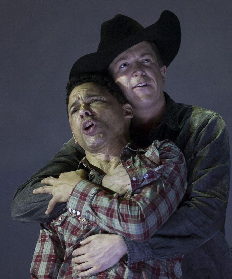 "In this photo taken on Friday, Jan. 24, 2014, American tenor Tom Randle (Jack Twist), left, and Canadian bass-baritone Daniel Okulitch (Ennis del Mar), right,  perform during the press rehearsal of the production ""Brokeback Mountain"" at the Teatro Real, in Madrid, Spain. It was a short story, then a Hollywood movie. Now the tragic tale of cowboys in love is being reinvented again: Brokeback Mountain _ the opera. Ahead of its world premiere in Madrid, author Annie Proulx told The Associated Press that the form of opera presented an opportunity to explore the complexities of the tale in a way neither her own short story nor the movie by director Ang Lee were able to do. (AP Photo/Gabriel Pecot)"