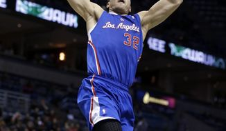 Los Angeles Clippers (32) Blake Griffin dunks against Milwaukee Bucks' Brandon Knight, back, during the first half of an NBA basketball game, Monday, Jan. 27, 2014, in Milwaukee. (AP Photo/Jeffrey Phelps)