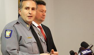 Lawrence, Kan., Police Chief Tarik Khatib, left, and Douglas County District Attorney Charles Branson discuss the filing of murder charges during a briefing Monday, Jan. 27, 2014, in Lawrence, Kan. Branson has filed first-degree murder charges against Sarah Brooke Gonzales McLinn for the Jan. 17 death of Harold M. Sasko. (AP Photo/John Milburn)