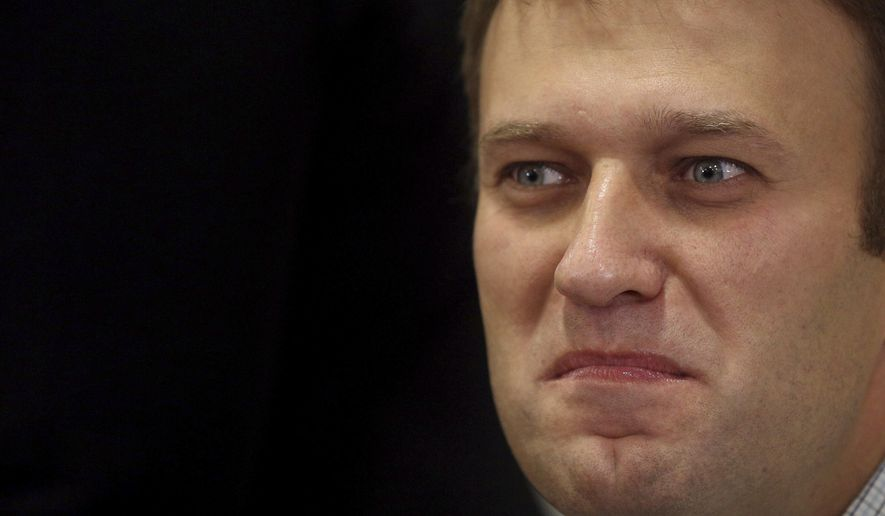 In this Sunday, Oct. 27, 2013 file photo, Russian opposition leader Alexei Navalny takes part in an opposition rally in downtown Moscow. (AP Photo/Ebgeny Feldman, File )