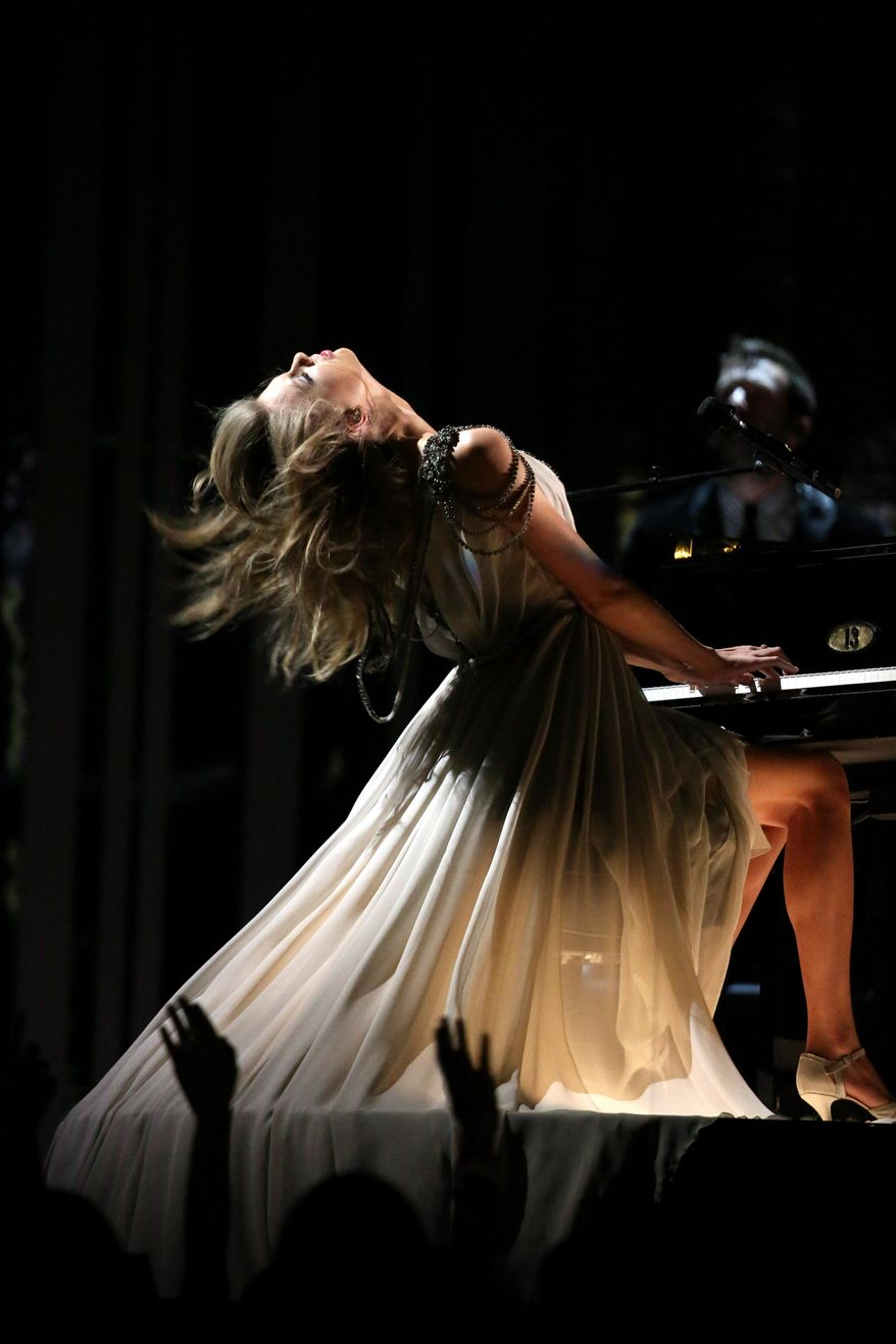 """Taylor Swift performs """"All Too Well"""" at the 56th annual Grammy Awards at Staples Center on Sunday, Jan. 26, 2014, in Los Angeles. (Photo by Matt Sayles/Invision/AP)"""