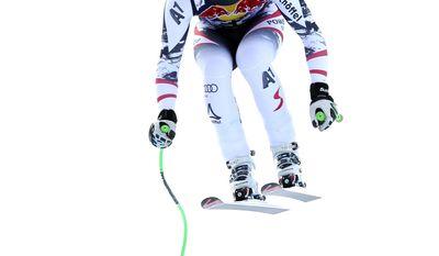 First placed Austria's Hannes Reichelt  speeds down the course during an alpine ski, men's World Cup downhill, in Kitzbuehel, Austria, Saturday, Jan. 25, 2014. (AP Photo/Shinichiro Tanaka)