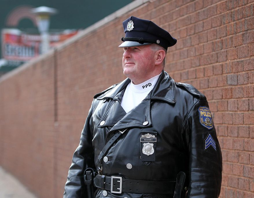 This photo taken Jan. 19, 2014, shows Philadelphia police Sgt. William McNamee posing outside the 35th police district building in Philadelphia, Pa. (AP Photo/Philadelphia Daily News, David Maialetti)