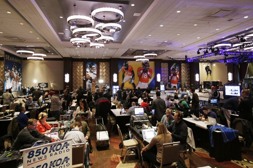 Broadcasters work on radio row at the NFL Super Bowl XLVIII media center, Monday, Jan. 27, 2014, in New York. The NFL's championship game between the Denver Broncos and Seattle Seahawks is scheduled for Sunday, Feb. 2 in East Rutherford, N.J. (AP Photo/Matt Slocum)