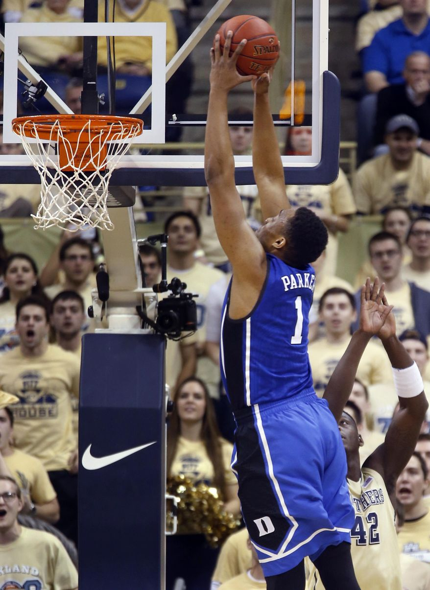 Duke's Jabari Parker (1) goes over Pittsburgh's Talib Zanna (42) for a dunk during the first half of an NCAA college basketball game on Monday, Jan. 27, 2014, in Pittsburgh. (AP Photo/Keith Srakocic)
